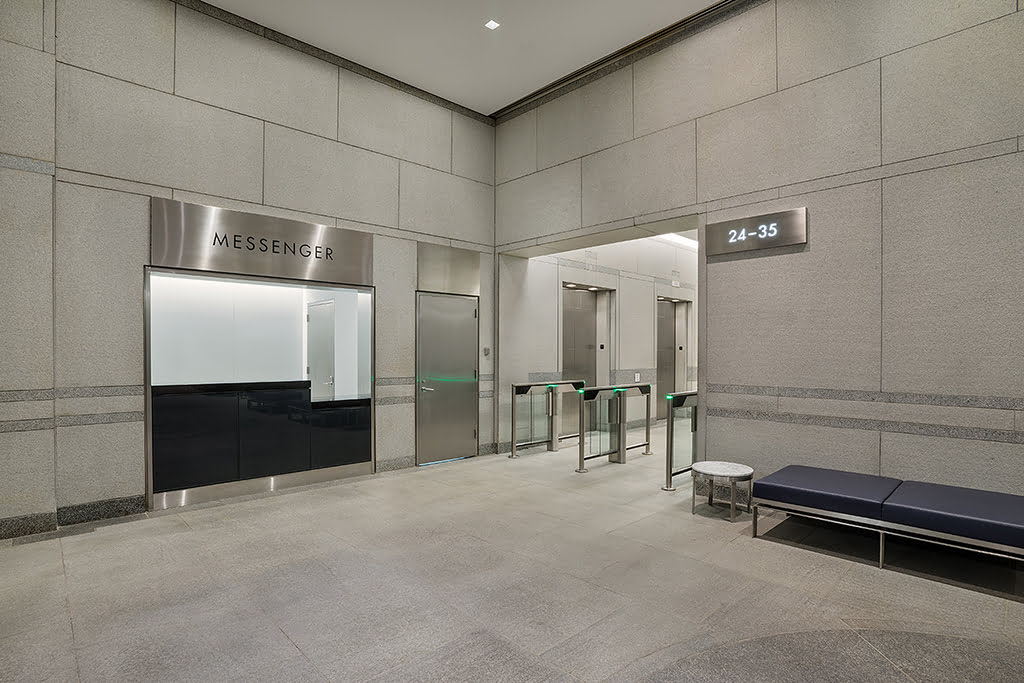 Interior lobby at 199 Water Street looking at messenger center and security turnstiles
