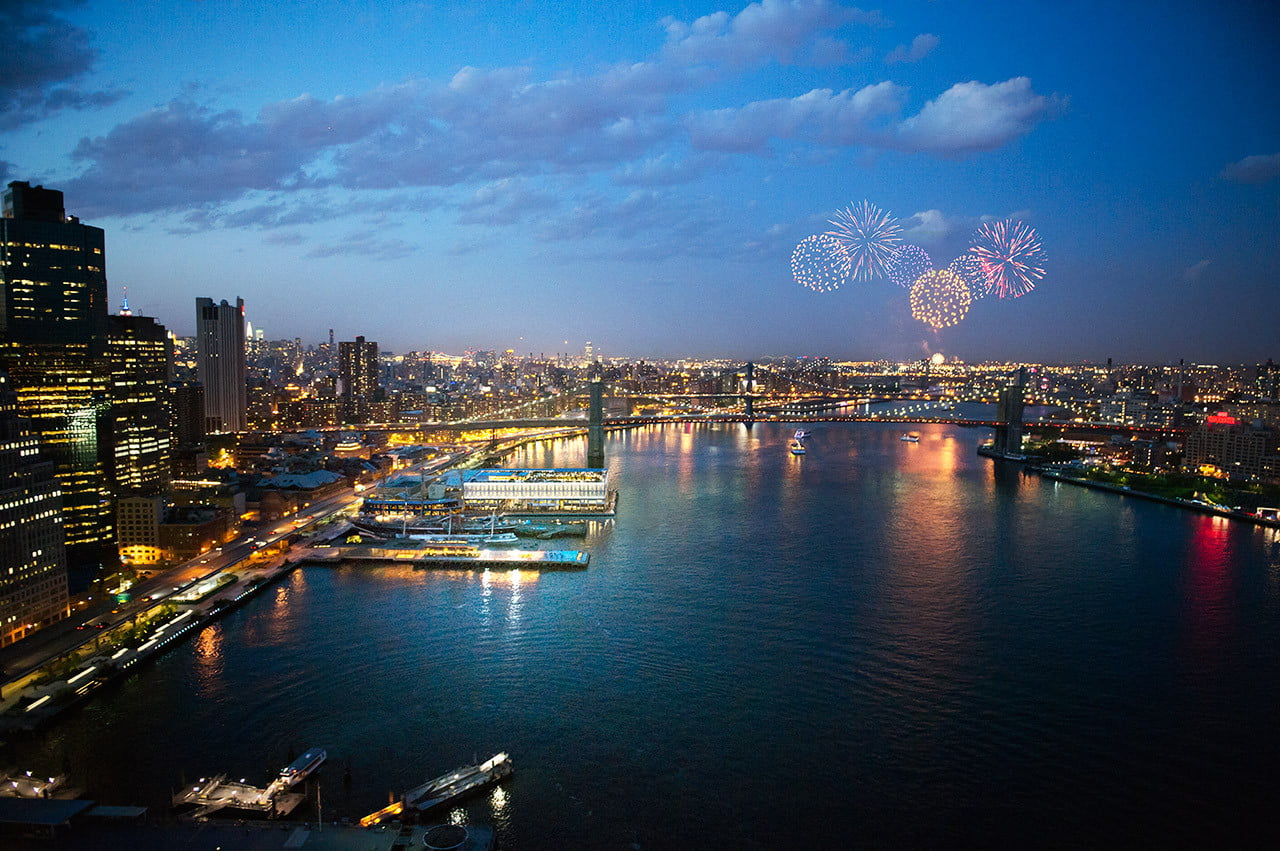 Looking North on East River of Brooklyn Bridge during fireworks celebration