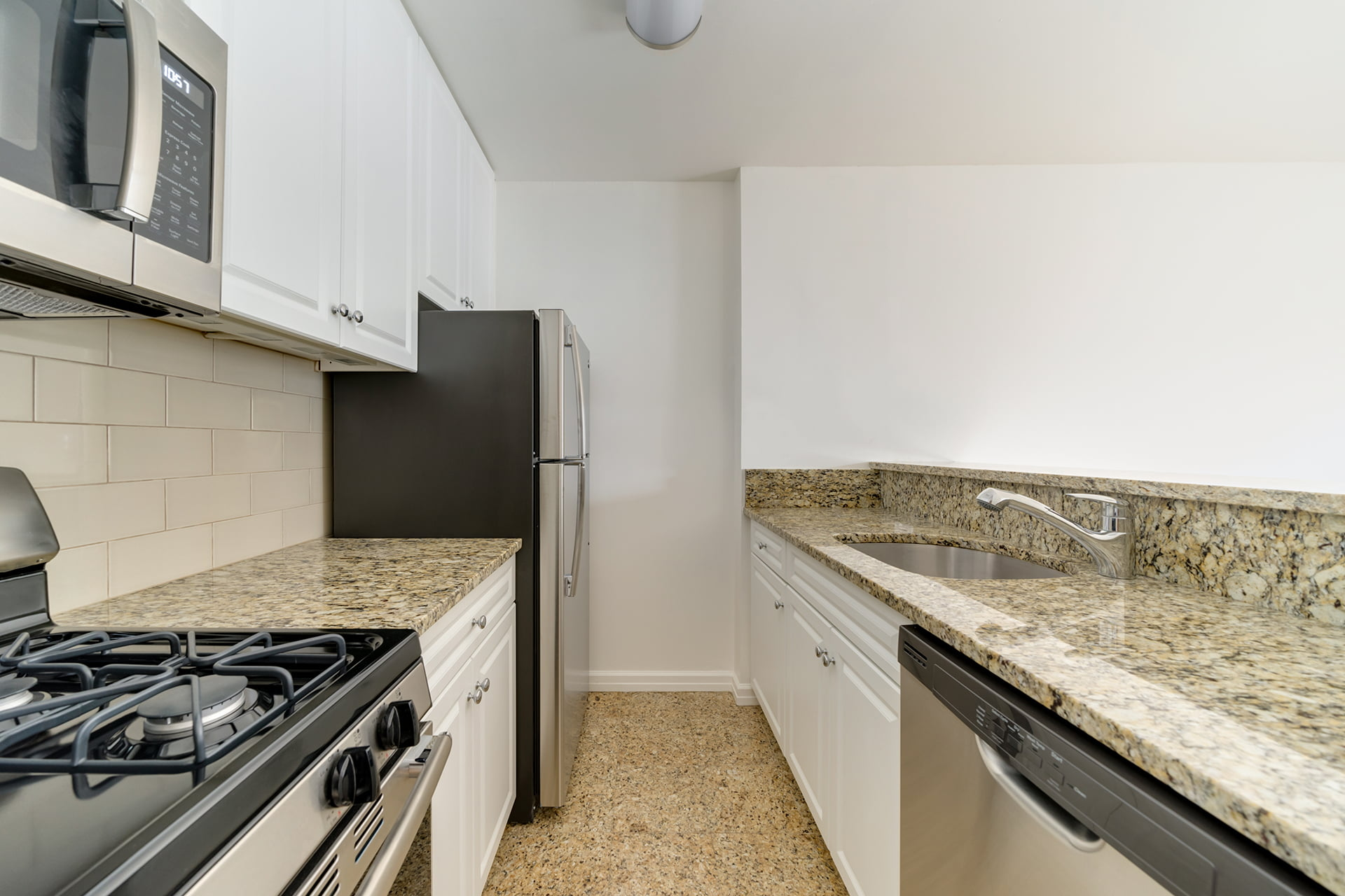 View of Symphony House apartment open kitchen located at 235 West 56th Street