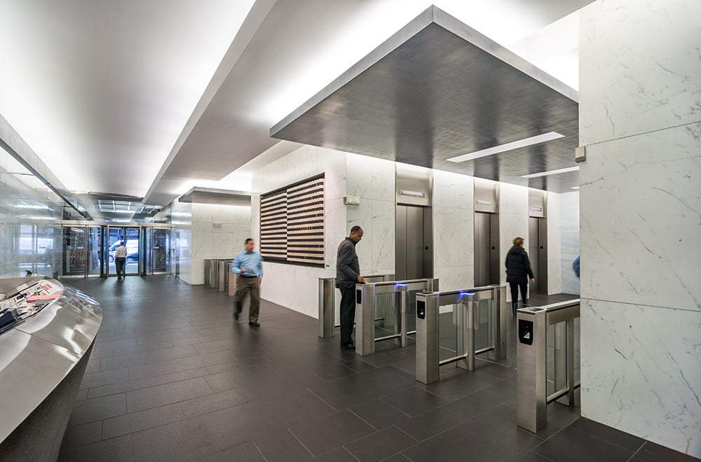 110 East 59th Street North lobby security turnstiles between Park Avenue and Lexington Avenue