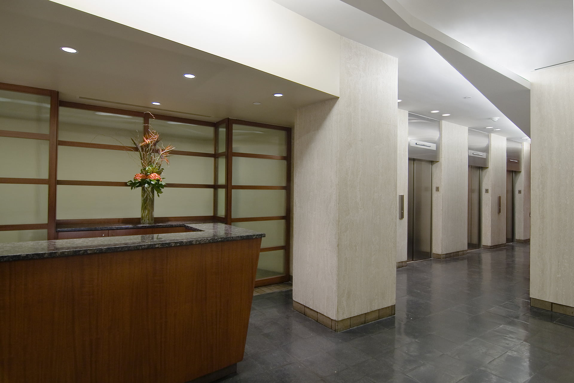 Interior lobby at 133 East 58th Street looking at security desk and elevator banks