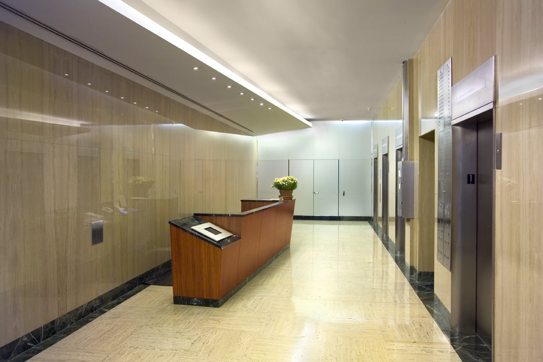 Interior lobby at 161 William Street looking at security desk and elevator cabs