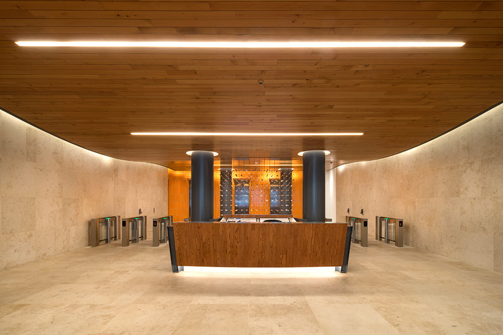 View of security lobby desk and turnstiles at 315 Hudson