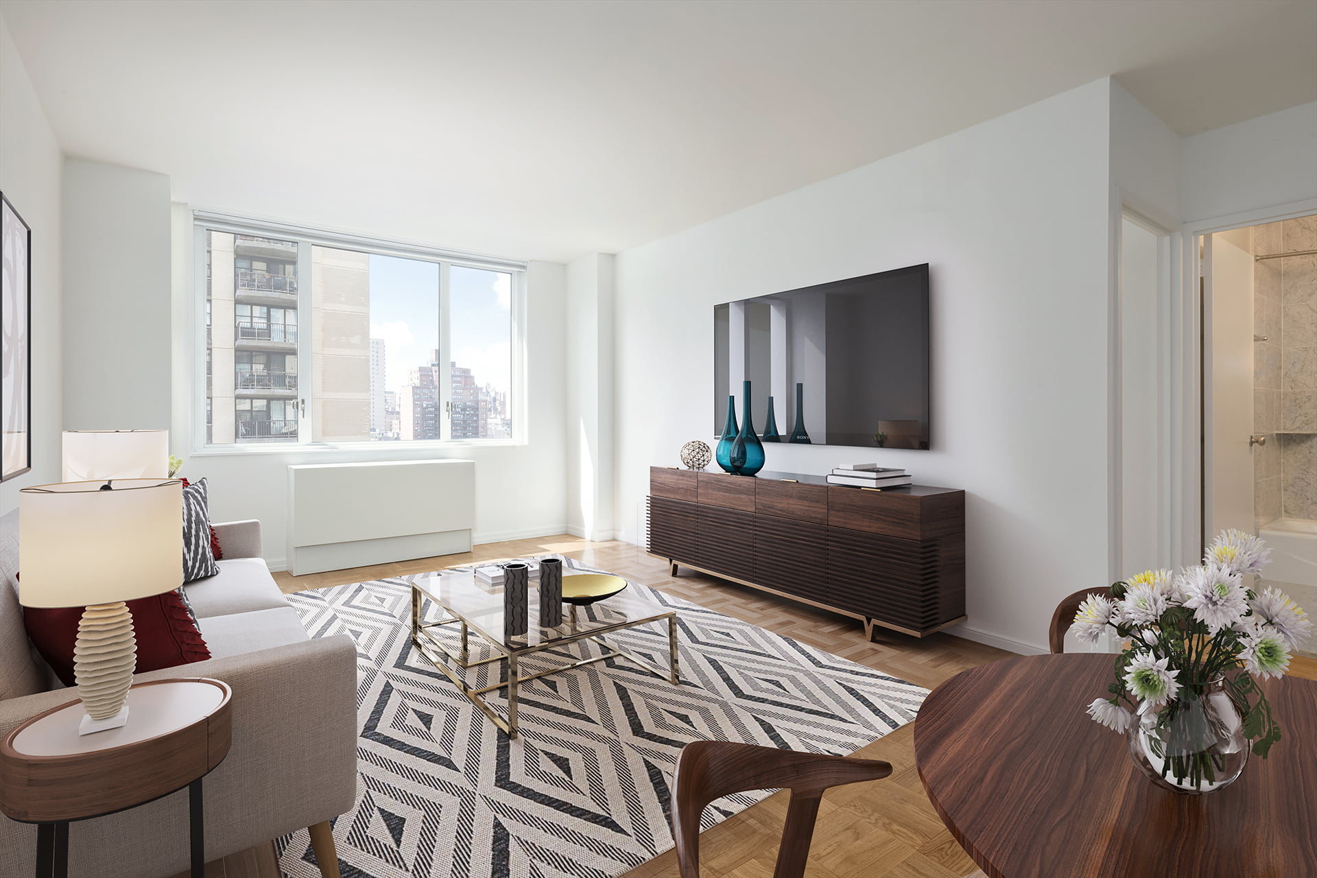 View of Gracie Mews staged living room located in the D line at 401 East 80th Street